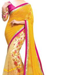 Yellow embroidered Net saree with blouse shop online