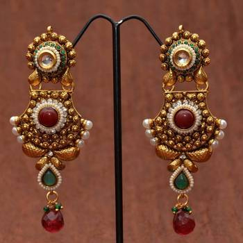 Anvi's Designer Earrings with Floral Work
