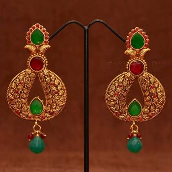 Anvi's Classic leaf work chand bali with rubies and emeralds