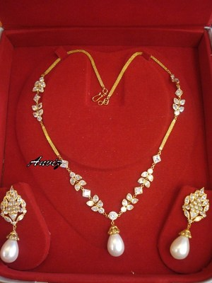 18k gold in white moti n polki with necklace