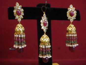 18k gold jhumkas with pendant in maroon colour