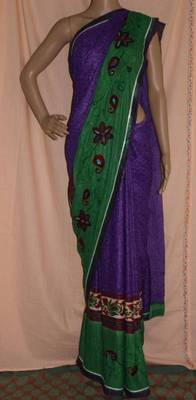 Purple and green embroidered crepe Saree