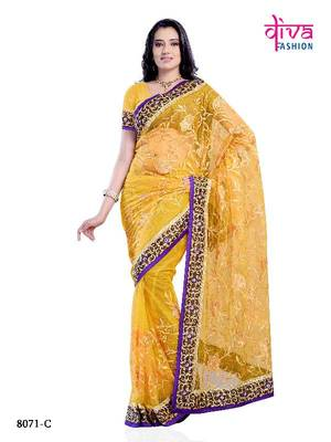 Dark Yellow Color Bollywood Designer Saree made from Net Fabric