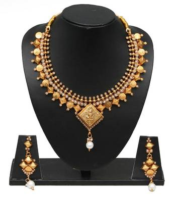 golden coloured ethnic necklace set
