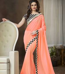 Buy Tomato embroidered georgette saree with blouse georgette-saree online