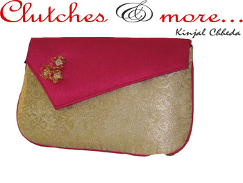 pink gold brocade clutch