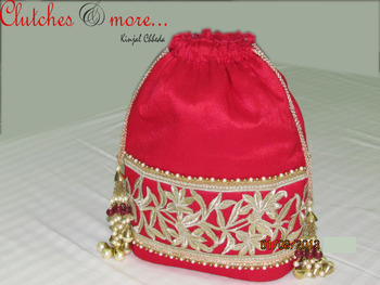 red cutwork potli