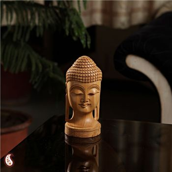 Dhyani Buddha face carved on wood