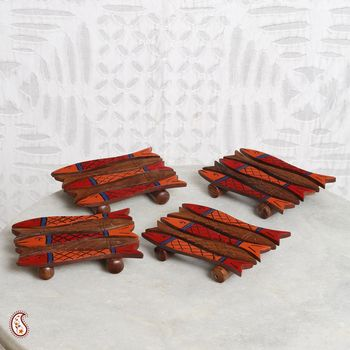 Fish shape wooden coasters in set of four