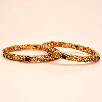 Anvi's beautiful bangles with jali design and stones combination