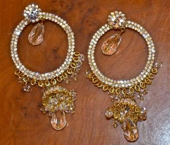 Elegant Jhumkas in gold diamond and crystals