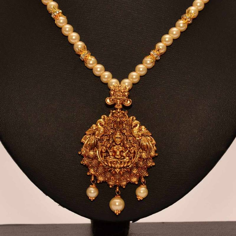 Anvi's lakshmi (temple jewellery) pendent with gold toned caps and pearls