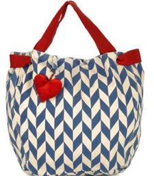 Buy Accrue with blue prints and heart shaped tassel.  potli-bag online