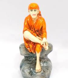 Buy Sai Baba sitting on rock Resin Material Multicolor religious-item online