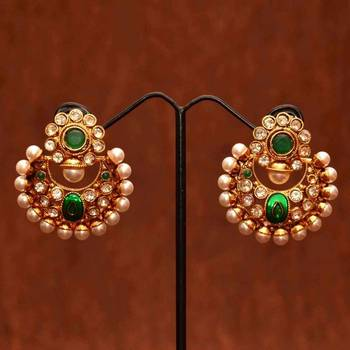 Anvi's polki chand bali with emeralds, pearls and enamel