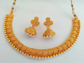 Glamorous Gold Designer Necklace Set in Perfect Harmony with Pearls.