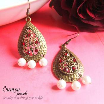 Drop brass earrings with red highlights