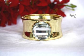 Lovely golden handcuff with Round Diamond