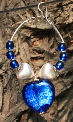 Sterling silver and Electric Blue hoops.