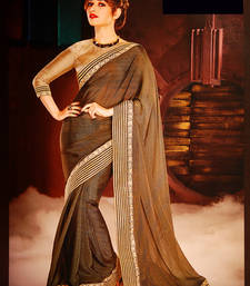 Buy BROWN embroidered georgette saree with blouse religious-item online