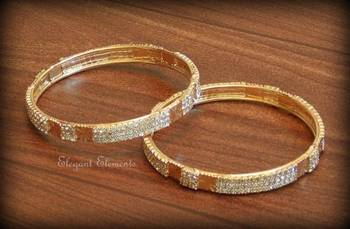 Bollywood style designer zircon stud golden plated bangles(set of 2)