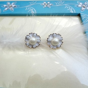 beautiful flower studs with pearl in the centre