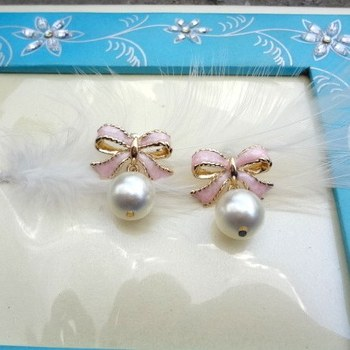 pink enamelled ribbon studs with pearl drop