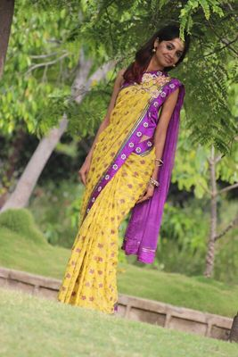 Yellow georgette embroidered semi stitched saree