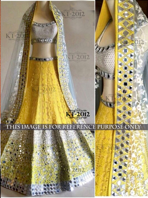 25dd624042a ... Yellow net embroidered Plastic Mirror work Semi stitched lehenga