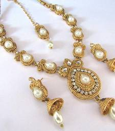 Buy Golden Pearl kundan with stone necklace set necklace-set online