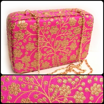 Pink clutches embroidered