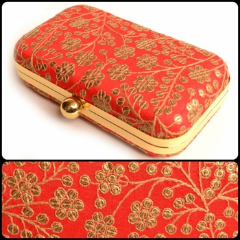 Red clutches embroidered