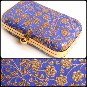Blue clutches embroidered