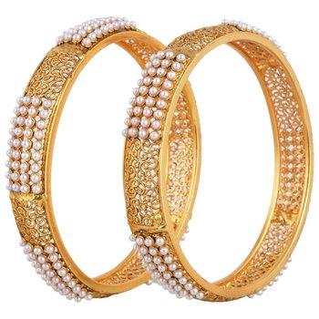 A Roayal pair of traditional pearl bangles