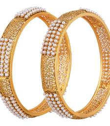 A Roayal pair of traditional pearl bangles