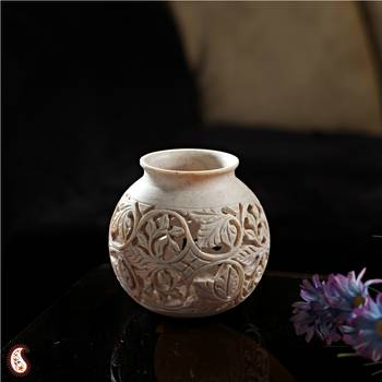Round carved stone vase