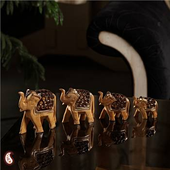 Set of Four carved wooden elephants