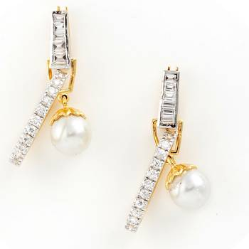 An Ultimate Pair Of Earrings With Zirconia And Pearls