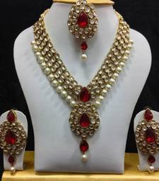 Buy Dazzling Kundan Set in White and Red with Pearls necklace-set online