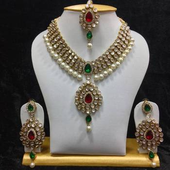 8015bdd167a16 Dazzling kundan set in red and green stones and pearls