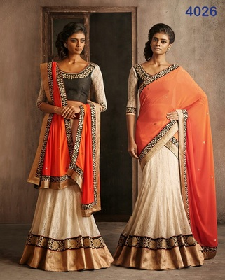 white embrodered brasso designeer lehngha choli with blouse and orange dupatta