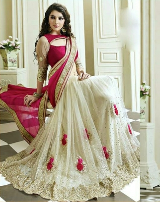 White and pink embroiderd net saree with blouse