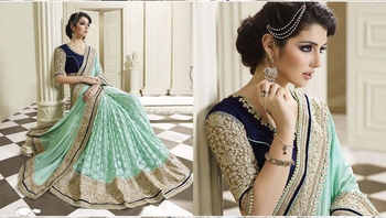 Light teal embroidered net saree With Blouse