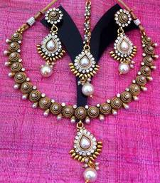 Buy Rope coil motif in pearl south indian temple collection necklace set j27w Necklace online