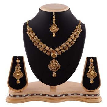 Traditional Wear Austrian Stone Gold Finishing Necklace Set With Maang Tikka