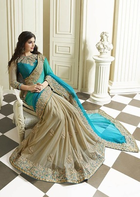 Aqua and cream embroidered georgette saree with bloluse