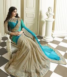 Buy Aqua and cream embroidered georgette saree with bloluse designer-embroidered-saree online