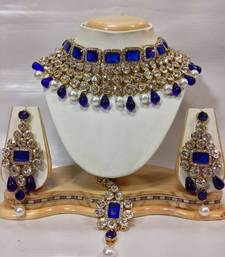 Buy Crystal Studed Jewelry Set in Royal Blue with Pearls women-ethnic-wear online