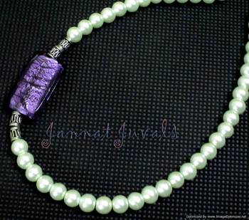 Ethnic pearl and violet side pendant Necklace