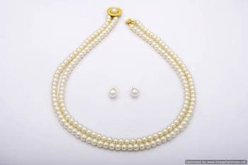 SIMPLE & SOBER DOUBLE STRING SHELL PEARLS SET FROM HYDERABAD - PCN1012